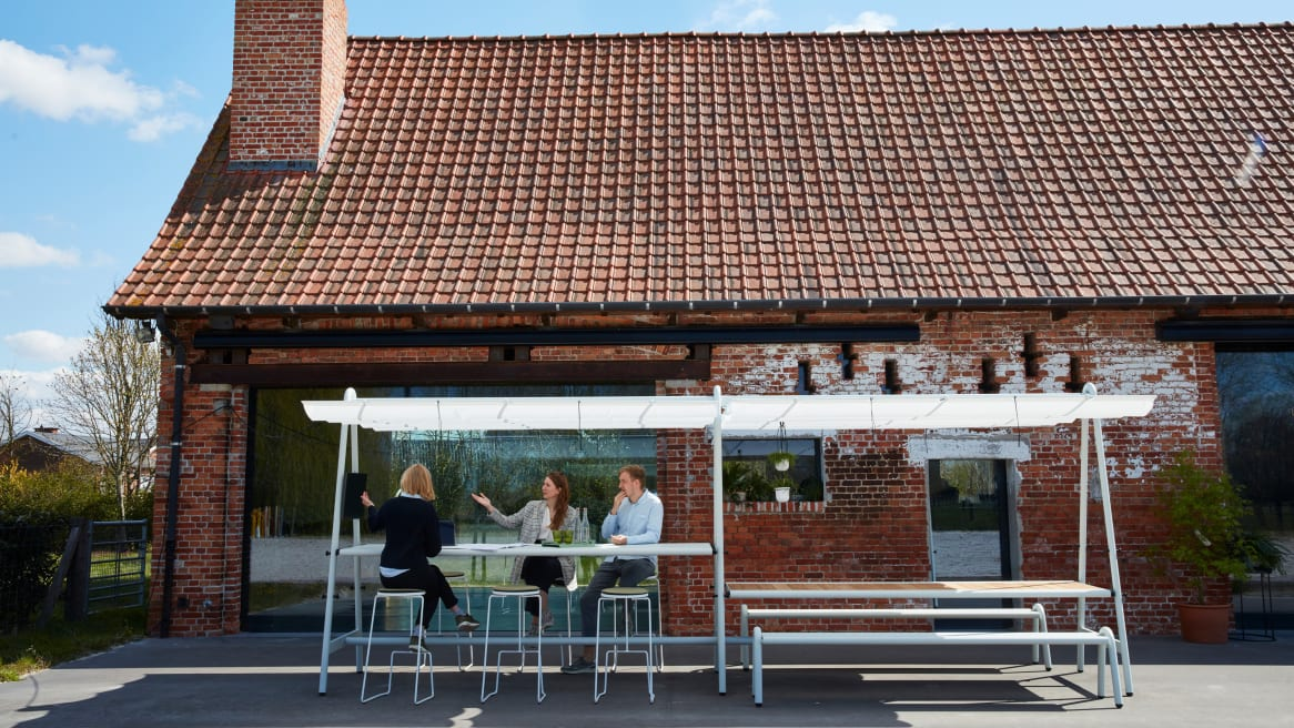 people sitting outside a brick house