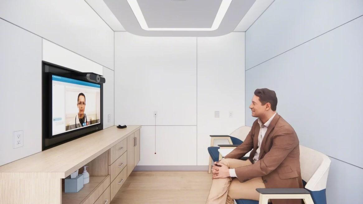 man having a virtual meeting inside a room