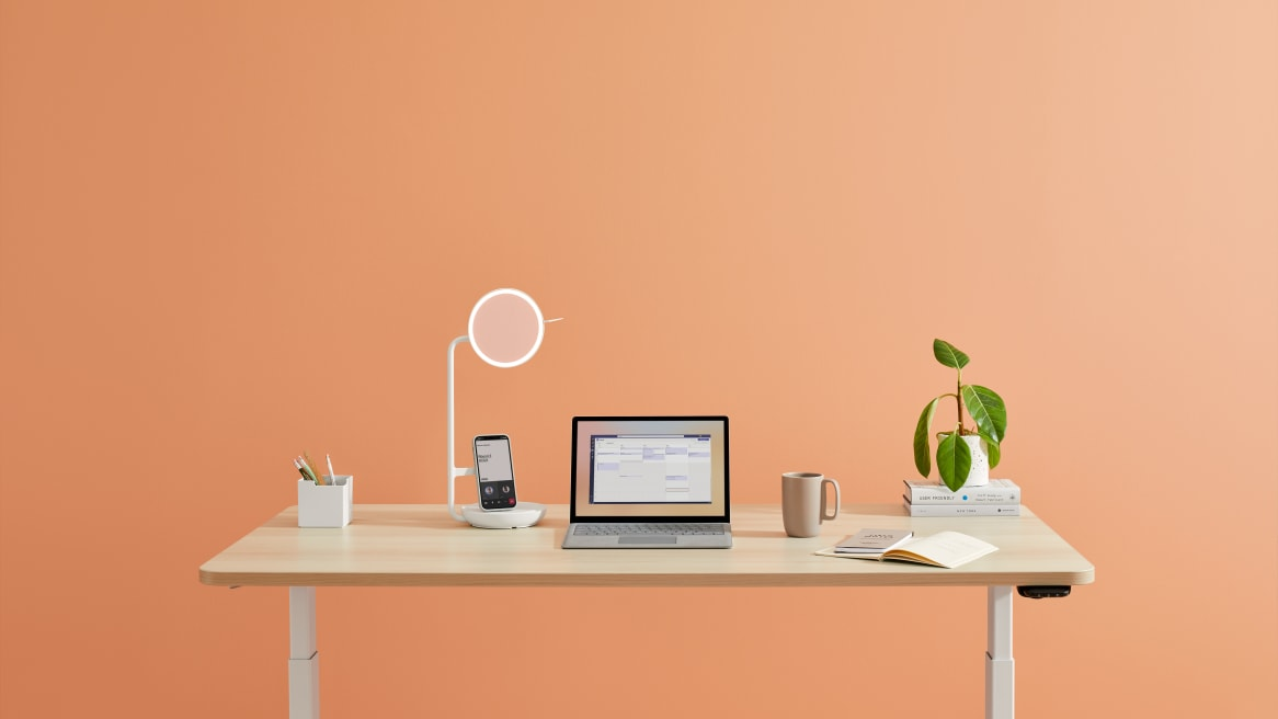 Pearl Snow Eclipse Light on top of Solo Height-Adjustable Desk