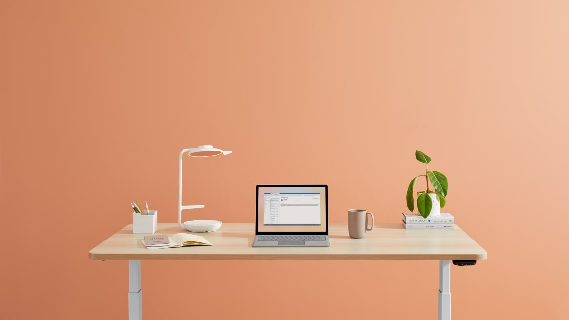 Steelcase Eclipse Light in task orientation on top of a height-adjustable desk