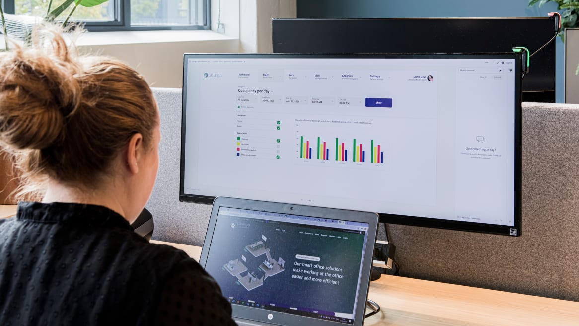 Woman in front of a desktop with the GoBright Work application opened