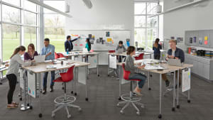 Verb Tables and Whiteboards and red Node Chairs in an active learning classroom setting