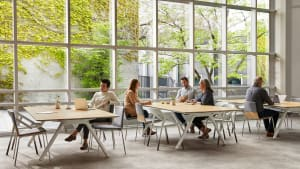 Three Potrero415 tables and LessThanFive and Montara650 chairs are used in a cafe setting by windows